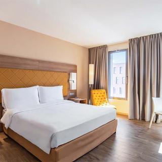 Décor pour votre tournage : chambre spacieuse de l'hôtel Radisson